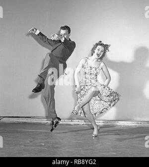 Charleston dance. A Dance named for the harbor city of Charleston, South Carolina and was popularized in the United States by a 1923 tune called The Charleston. The peak for the Charleston as a dance by the public was mid 1926 to 1927. Pictured Sonja Stjernquist and John Ivar Deckner dancing the Charleston 1950.  Photo Kristoffersson ref BA67-9 - Stock Photo