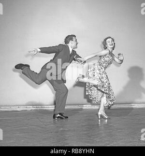 Charleston dance. A Dance named for the harbor city of Charleston, South Carolina and was popularized in the United States by a 1923 tune called The Charleston. The peak for the Charleston as a dance by the public was mid 1926 to 1927. Pictured Sonja Stjernquist and John Ivar Deckner dancing the Charleston 1950.  Photo Kristoffersson ref BA68-5 - Stock Photo