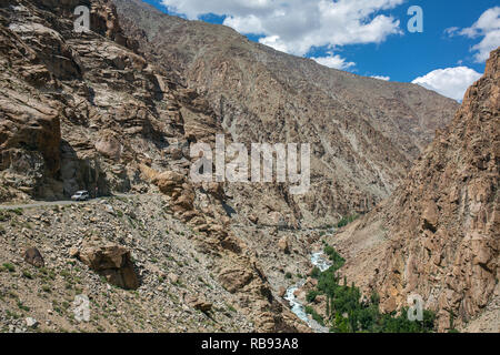 Car on the high altitude mountain road in Ladakh, Himalaya mountains, India - Stock Photo