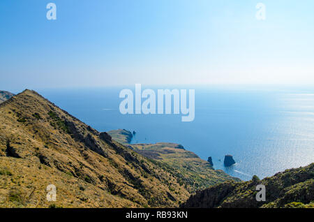 Stunning view of the cliffs and rocky coastline in Lipari with faraglioni on the tyrrhenian sea. Aeolian islands, Sicily - Stock Photo