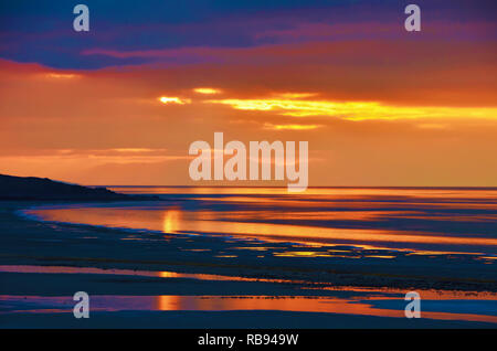 Golden sunset and reflection on The Great Salt Lake. - Stock Photo