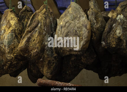 Cured jabugo ham hung in butchery, food and nutrition - Stock Photo