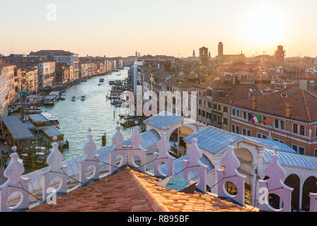 Sunset view on the Grand Canal and roofs in Venice, Italy - Stock Photo