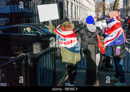 London, UK. 8th Jan, 2019. Pro-Brexit protesters bearing Union Jacks and placards shout at a Minister leaving 10 Downing Street following the first Cabinet meeting since the Christmas recess. Credit: Mark Kerrison/Alamy Live News - Stock Photo