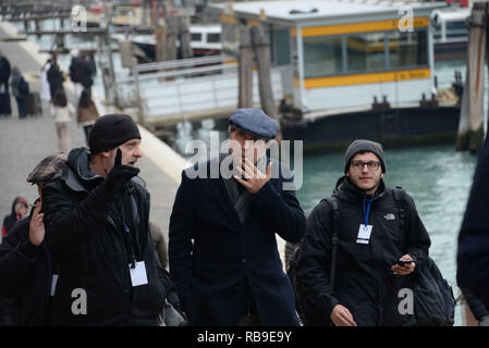 Venice, Italy. 08th January, 2019. The Italian director Paolo Sorrentino (in the middle while smoking the cigar) walks with the crew during a break from the set of the tv show 'The New Pope' in Venice, Italy. Andrea Merola / Awakening / Alamy Live News - Stock Photo
