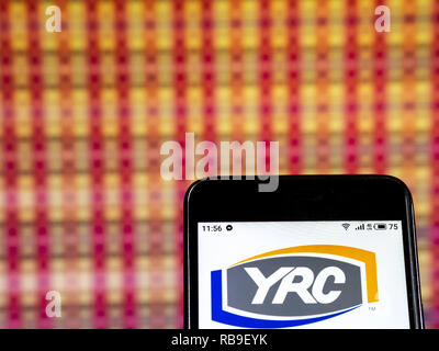 YRC Worldwide Holding company logo seen displayed on smart
