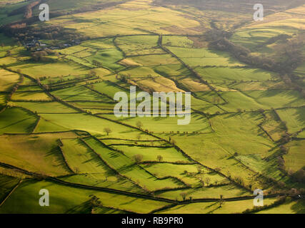Winter light casting shadows on Lake District field patterns, north of Bassenthwaite Lake, Cumbria, NW England, UK - Stock Photo
