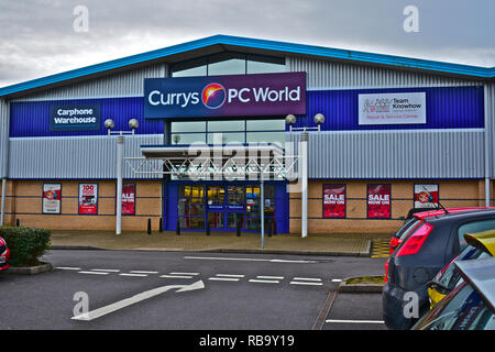 Front view of Currys PC World retail store in Bridgend. Electrical & electronic goods, computers. Sale now on signs. Bridgend, South Wales - Stock Photo