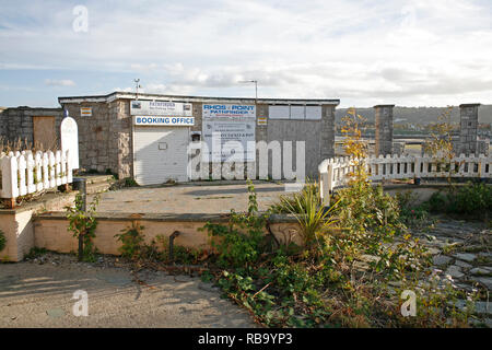 Rhos Point in Rhos On Sea, Conwy. Shops boarded up and deteriorating after being closed by the council and left to rot. - Stock Photo