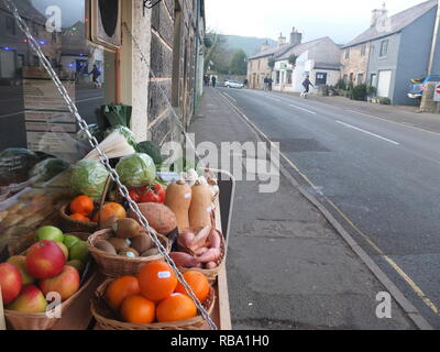 Fresh local produce for sale outside a general stores/greengrocers shop (Peveril Stores) in an English village (Castleton, Derbyshire Peak District) - Stock Photo