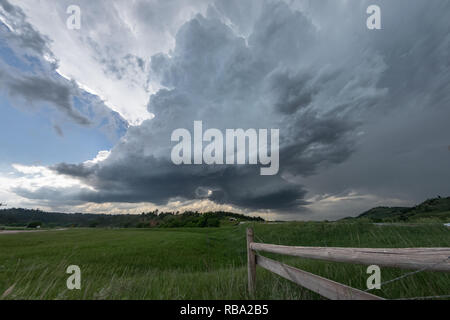 Rotating wall clouds of a South Dakota supercell thunderstorm. Storms fired over the Black Hills in South Dakota and drifted eastwards to the plains. - Stock Photo