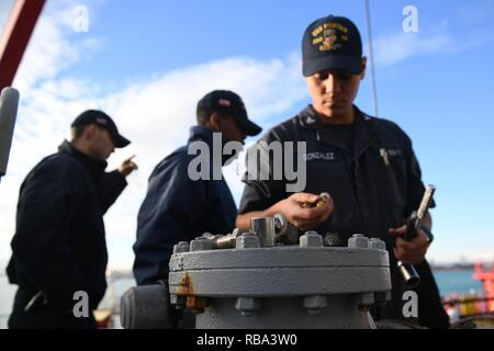 - VALENCIA, Spain (Dec. 20, 2016) Petty Officer 3rd Class Enrique Gonzalez, from San Bernardino, Calif., checks his tools aboard the guided-missile destroyer USS Porter (DDG 78) as the ship prepares to take on fuel pier-side in Valencia, Spain, Dec. 20, 2016. Porter, forward-deployed to Rota, Spain, is conducting naval operations in the U.S. 6th Fleet area of operations in support of U.S. national security interests in Europe. - Stock Photo