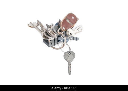 Many old keys on a ring with a torn keychain isolated on white background - Stock Photo