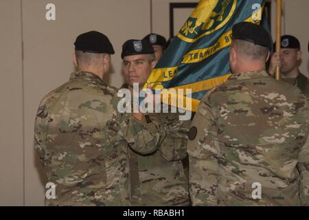 Col. Fernando Guadalupe Jr., commander of the Leader Training Brigade, receives the unit colors from Maj. Gen. Anthony C. Funkhouser, Center of Initial Military Training commander during a change of command ceremony Jan. 6 at the Officers Club on Fort Jackson. Guadalupe took command of the unit from Col. Michael Mammay who is retiring. - Stock Photo