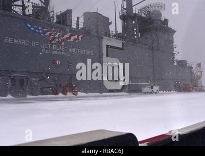 NORFOLK, Va., (Jan. 7, 2017) Snow falls on the flight deck of the multipurpose amphibious assault ship USS Bataan (LHD 5). Bataan is currently inport preparing for an upcoming planned deployment. - Stock Photo