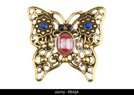 Vintage golden brooch shaped like a butterfly, with small colored beads, isolated on white background, clipping path included - Stock Photo