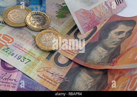 Bank Of Scotland, Clydesdale & RBS plastic £5 £10 Five pound and ten pound bank notes, with coins - Stock Photo