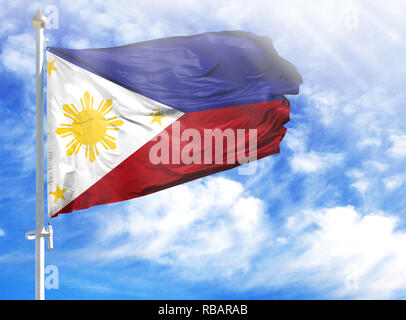 National flag of Philippines on a flagpole in front of blue sky. - Stock Photo
