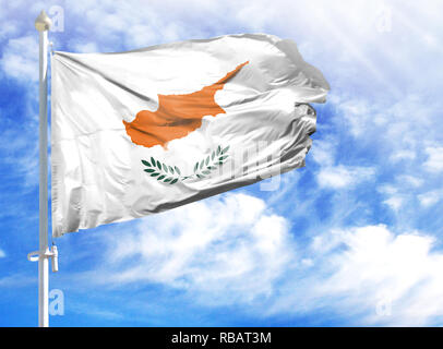 National flag of Cyprus on a flagpole in front of blue sky. - Stock Photo