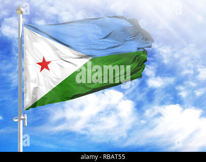 National flag of Djibouti on a flagpole in front of blue sky. - Stock Photo