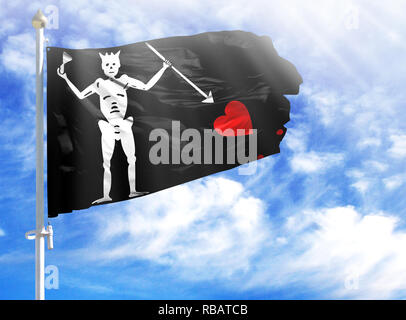 National flag of Blackbeard Pirate on a flagpole in front of blue sky. - Stock Photo