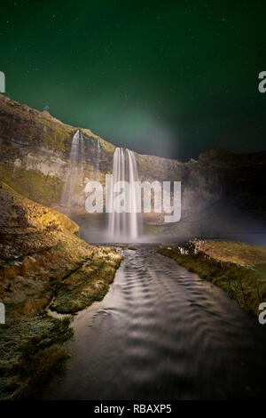 Seljalandsfoss Waterfall and Aurora Borealis, Iceland - Stock Photo