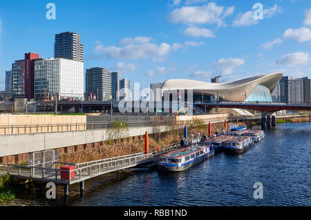 Stratford East London UK skyline, with the Waterworks River and the London Aquatics Centre in Queen Elizabeth Olympic Park - Stock Photo