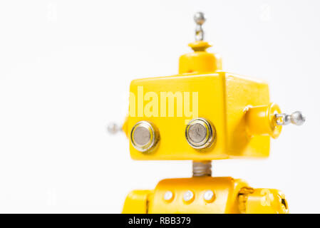 Portrait of a Cute, yellow, handmade robot on a white background. - Stock Photo