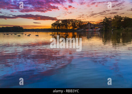 Beautiful sunset over lake - Stock Photo