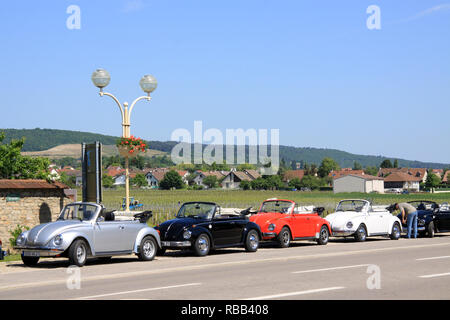 Volkswagen beetle cabriolet convertible in the Burgundy town of Gevrey- Chambertin France on an owners club rally drive outing in French countryside - Stock Photo