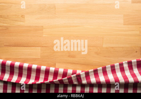Red checkered fabric on wood table background.For decoration key visual layout - Stock Photo