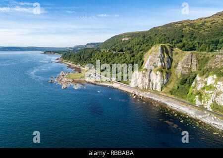 Garron Point in Northern Ireland, UK. A geological formation, parking and marina at Antrim Coast Road, a.k.a. Giants Causeway Coastal Route - Stock Photo