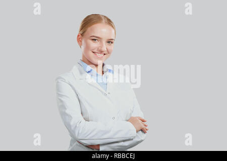 Woman doctor smiling blonde on a background. - Stock Photo