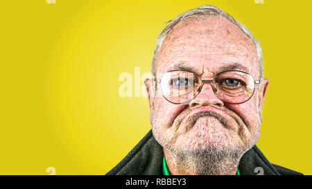 grumpy old man with glasses - Stock Photo