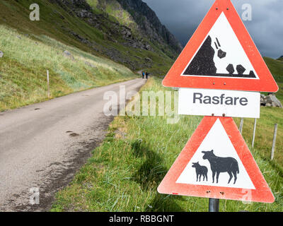 Old pass, mountain road from Haukland beach to Uttakleiv, warning signs, no public traffic, be aware of sheep and avalanches, Utakleiv, island Vestvag - Stock Photo