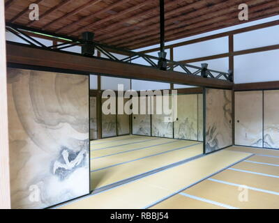 The interior of the Kuri or main temple hall with its tatami mats and decorated sliding bamboo screens; Ryoan-ji Temple, Kyoto - Stock Photo