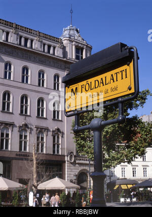 Budapest Metro sign on Vorosmarty ter, at the background the famous Café Gerbeaud, Budapest, Hungary - Stock Photo