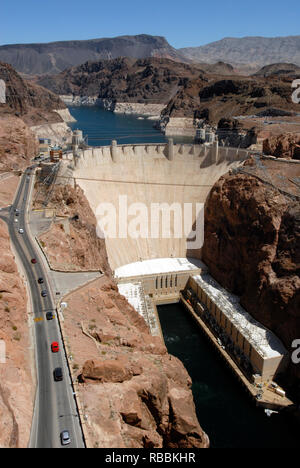 Vertical image showing the Hoover Dam and a portion of Lake Mead at the Arizona-Nevada border. The civil engineering landmark was dedicated in 1935. - Stock Photo