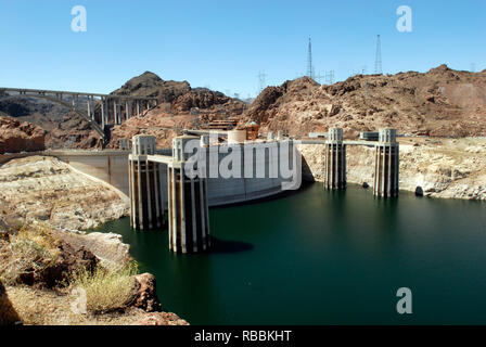 The intake towers behind the Hoover Dam, on the Arizona-Nevada border. The Mike O'Callaghan–Pat Tillman Memorial Bridge stands in the background. - Stock Photo
