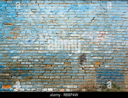 Old grungy blue brick wall texture - Stock Photo