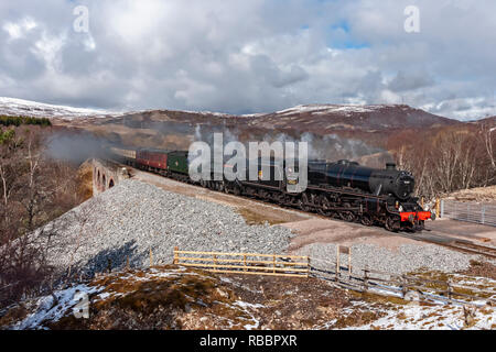 The North Briton Steam double header with Black Five No. 45407 and A4 60009 Union of South Africa is heading south on the Highland Line at Slochd - Stock Photo