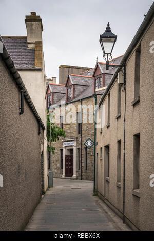 A narrow empty street in Kirkwall, Orkney, Scotland, United Kingdom, Europe. - Stock Photo