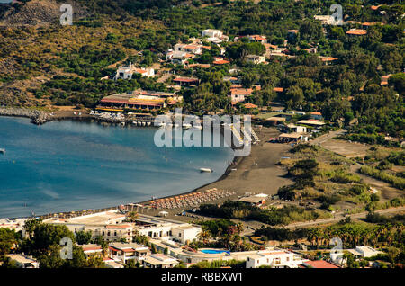 Panoramic aerial view of Black Beach, sea and faraglioni rocks from the top of the volcano crater of Vulcano, Aeolian Islands Archipelago, Sicily. - Stock Photo