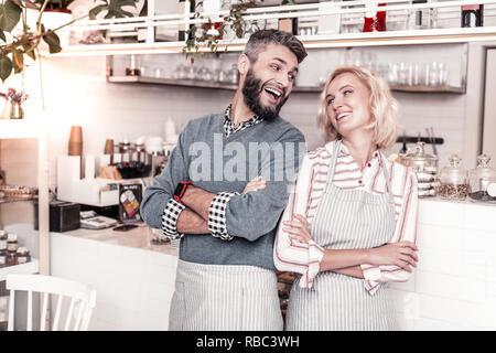 Joyful nice man looking at his girlfriend - Stock Photo