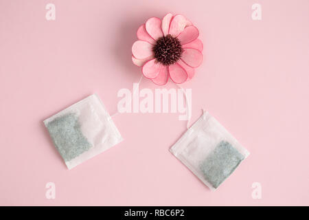 Flat lay of flower and tea bags minimal creative concept. - Stock Photo