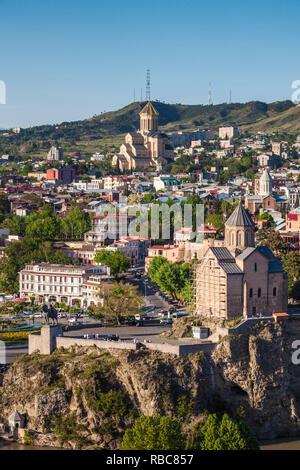 Georgia, Tbilisi, Tsminda Sameba Cathedral and Metekhi Church - Stock Photo