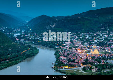 Georgia, Mtskheta, spiritual town where Christianity was established in 327AD, high angle view of town and Svetitskhoveli Cathedral - Stock Photo