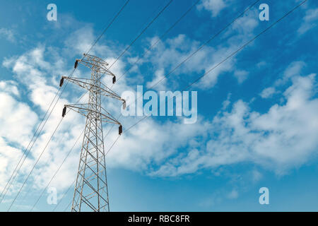 Electricity pylon in snow, winter scenery with lonely pole for power transmission - Stock Photo