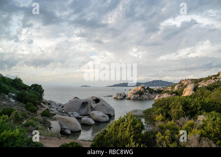 beach with rocks at the italian island sardinia in mediterranean sea - Stock Photo