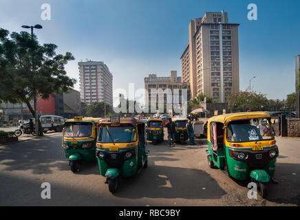Auto rickshaws waiting for customers near Nehru Place Metro Station with Eros tower in the background, near Satyam Cinema. New Delhi, India - Stock Photo